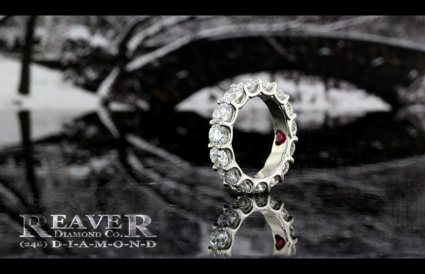 Ladies Plat RB Shared Prong Diamond Eternity Band with Heart Shaped Ruby Inside